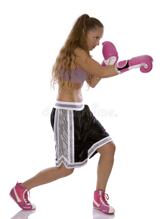 Female boxer. Active woman female boxer jumping high on white background royalty free stock image