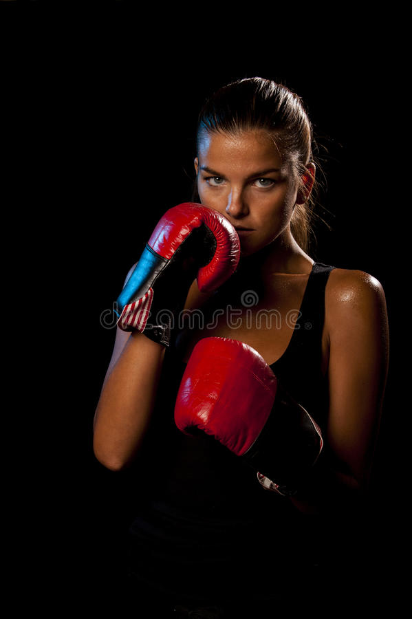 Female boxer on black background