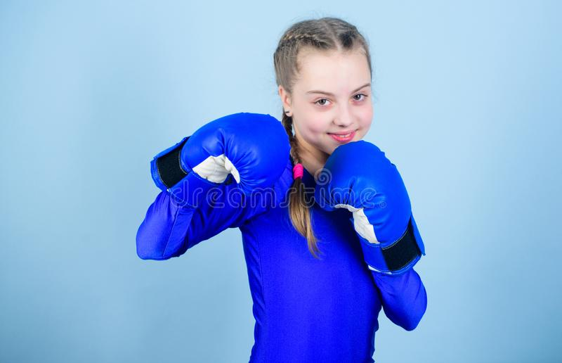 Female boxer change attitudes within sport. Feminism concept. With great power comes great responsibility. Boxer child. In boxing gloves. Girl cute boxer on royalty free stock image