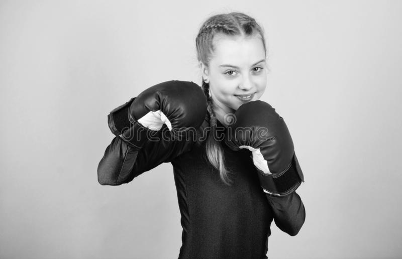 Female boxer change attitudes within sport. Feminism concept. With great power comes great responsibility. Boxer child. In boxing gloves. Girl cute boxer on royalty free stock images