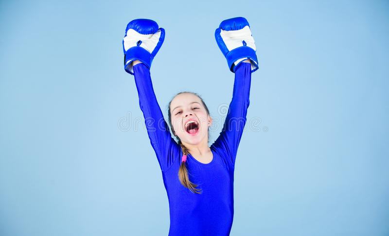 Female boxer change attitudes within sport. Rise of women boxers. Free and confident. Girl cute boxer on blue background. Female boxer change attitudes within stock photos
