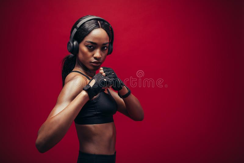 Female boxer with fighting stance stock images