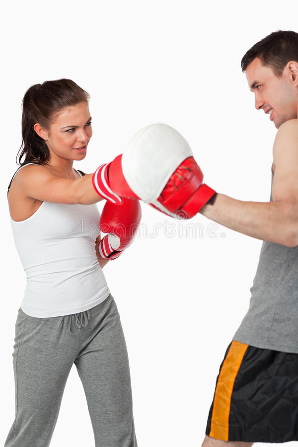 Female Boxer Listening To Her Instructor Royalty Free Stock Photography
