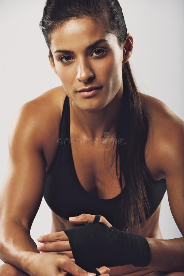Female boxer preparing for fight stock image