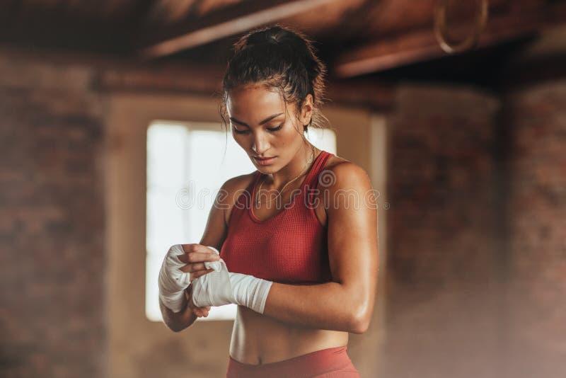 Female boxer wearing strap on wrist stock photo