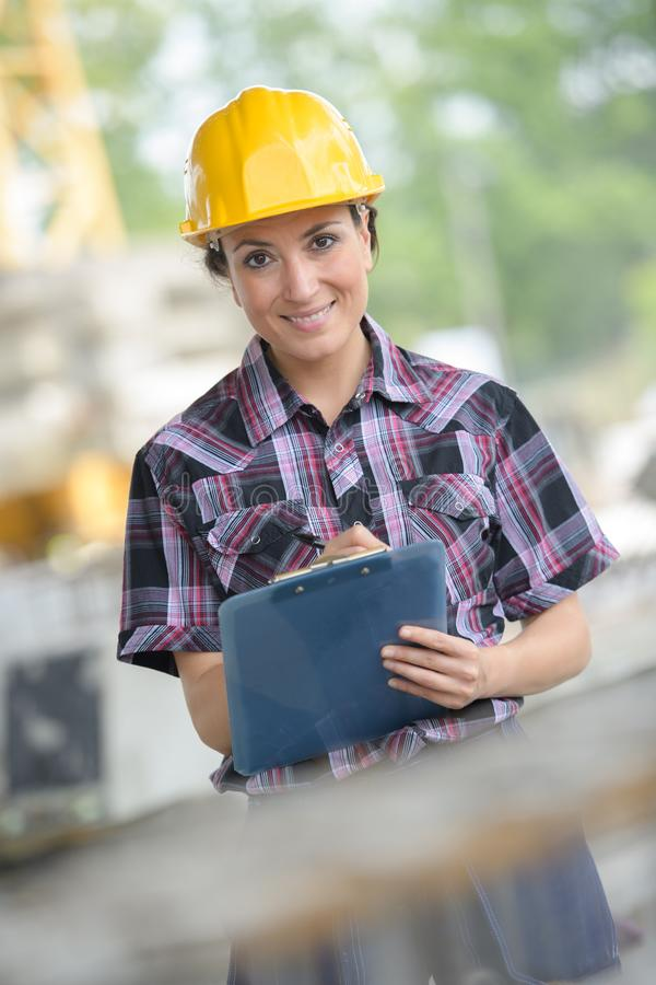 Female builder with clipboard royalty free stock photos
