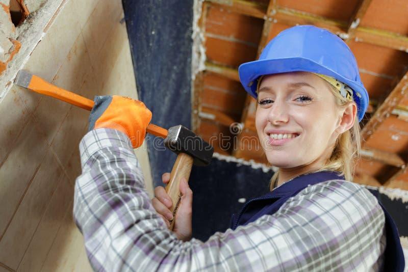 Female builder holding hammer stock photos