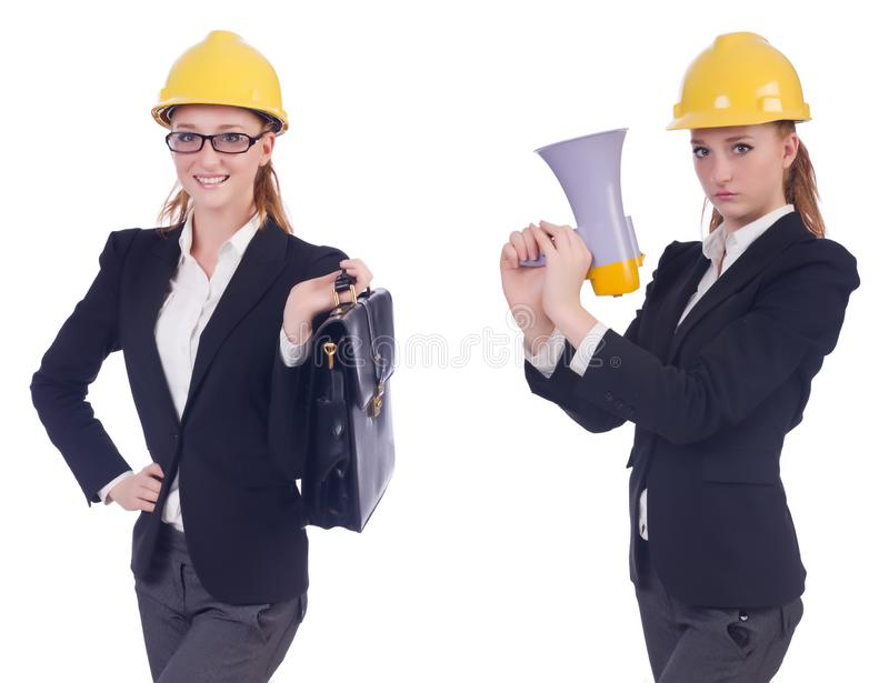 The female builder with megaphone isolated on white. Female builder with megaphone isolated on white royalty free stock photos