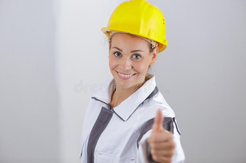 Female builder with thumbs up royalty free stock image