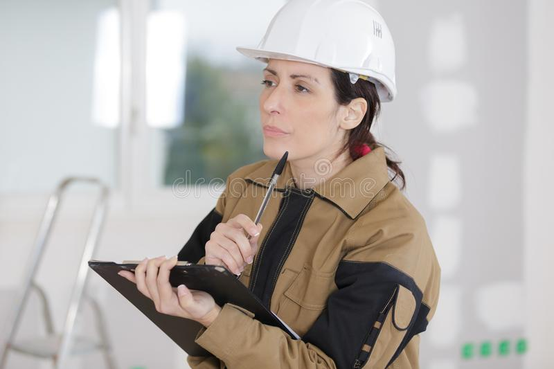 Female building manager doing inspection royalty free stock image