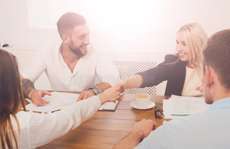 Female business handshake at office meeting, contract conclusion and su stock image