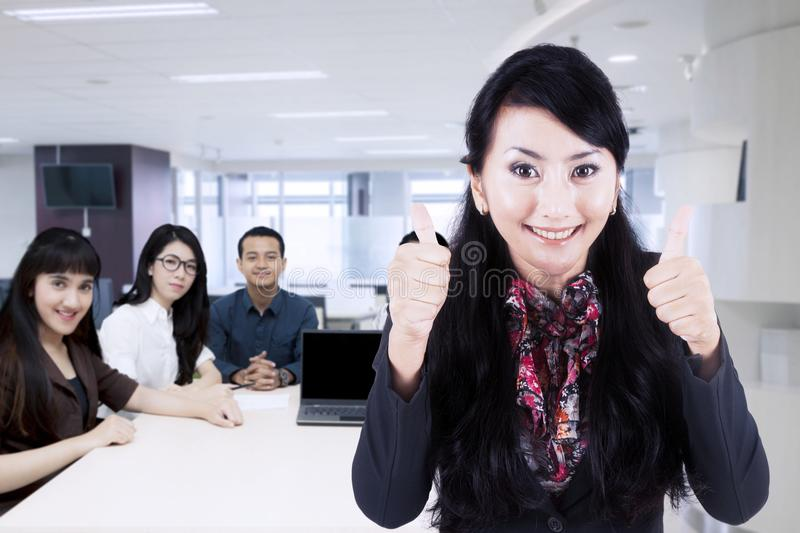 Female business leader with her team in office royalty free stock photo