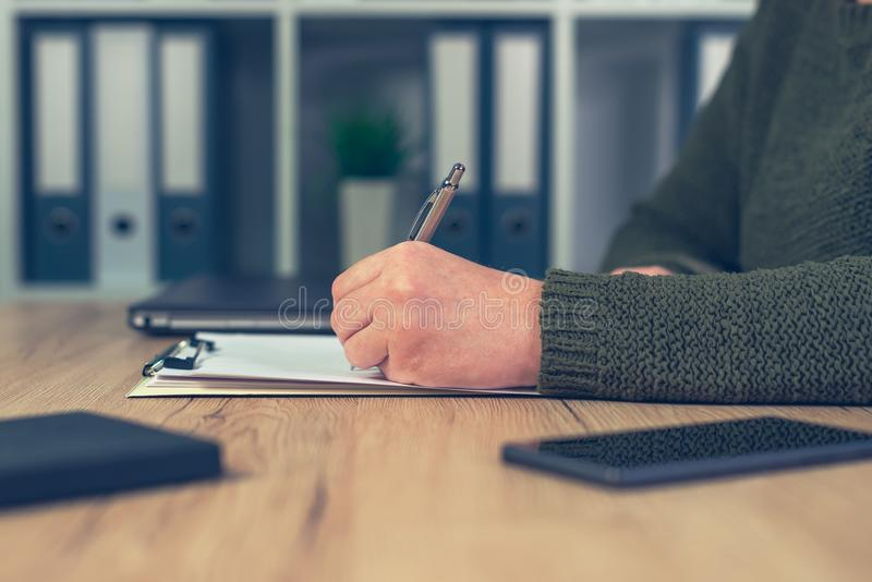 Female business person writing notes stock photos