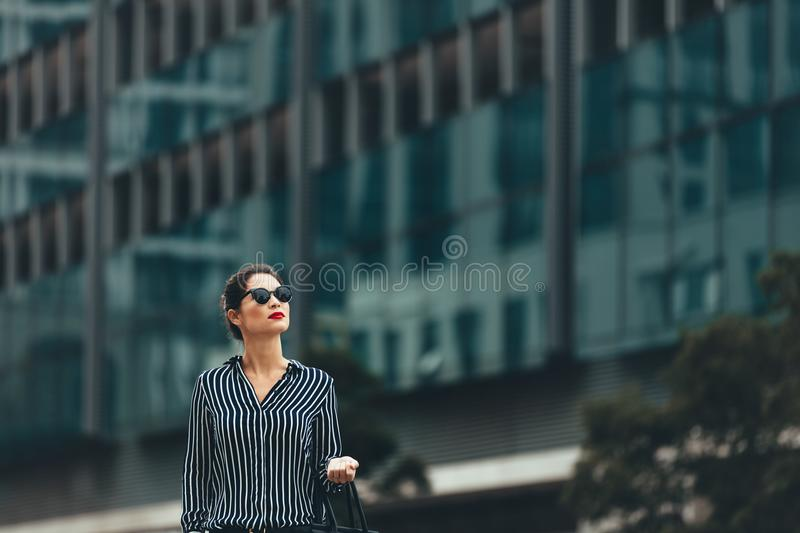 Female business professional outside an office building stock photo