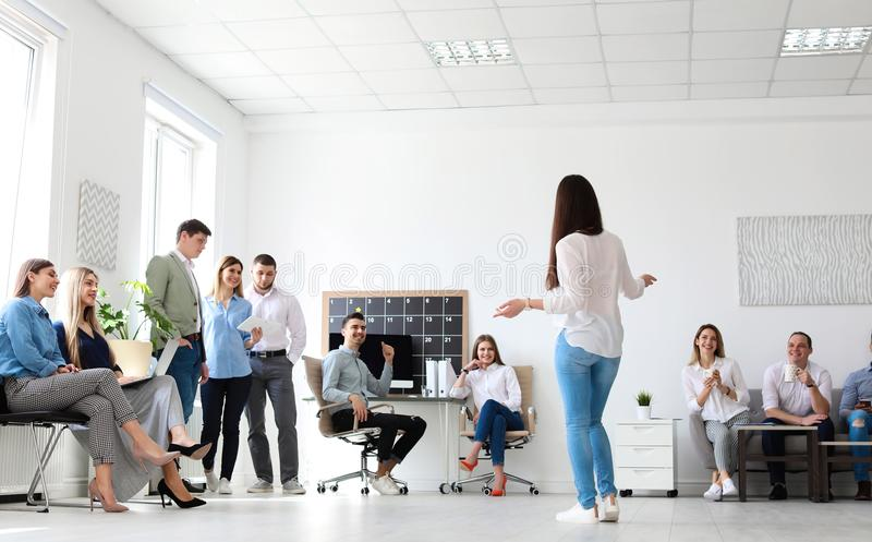 Female business trainer giving lecture stock photography