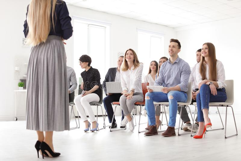 Female business trainer giving lecture stock photos