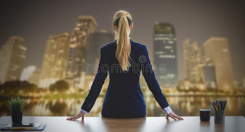 Female business woman looking out the windows for night busin stock images