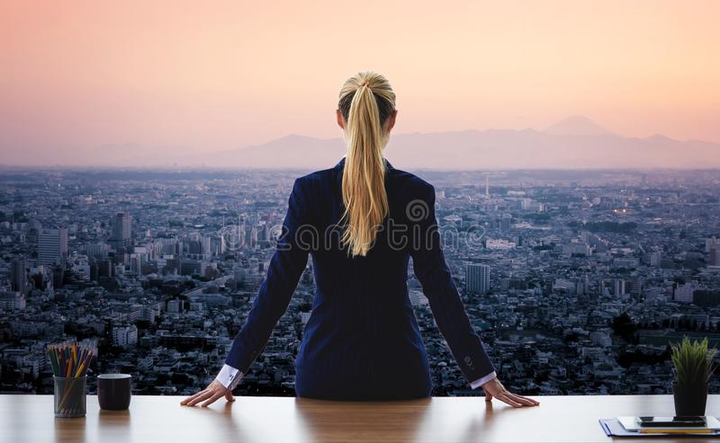 Female business woman looking out the windows for success royalty free stock photos