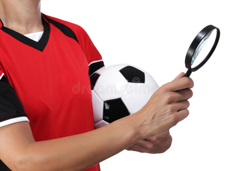 Female bust in Football Uniform holding a magnifying glass. Photography of a female bust in Football Uniform holding a magnifying glass royalty free stock photography