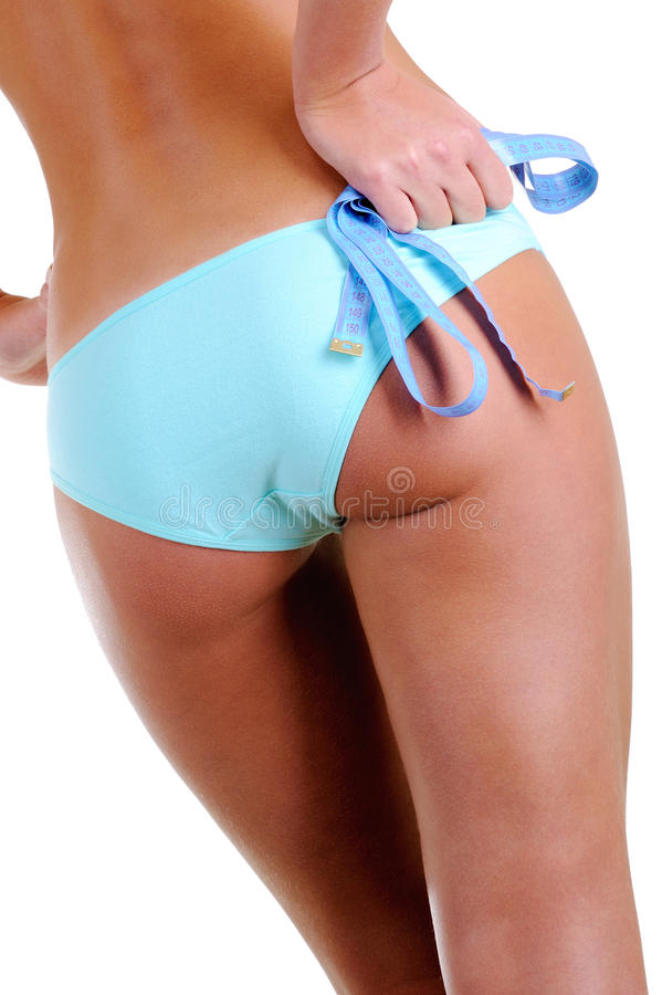 Download Female Buttocks  With A Measurement Tape In Hads Stock Photo - Image: 11756616