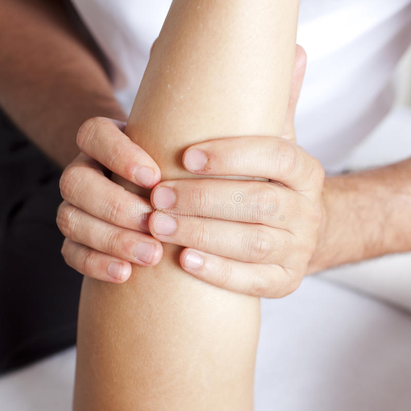 Female calf muscle. Massage of a woman's calf muscle stock photos