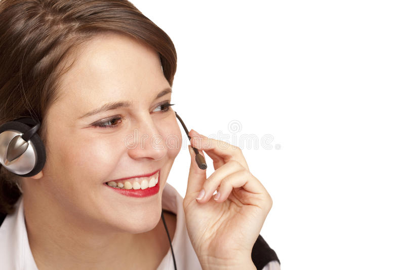 Female Call center operator calling friendly. With headset. Isolated on white background royalty free stock photography