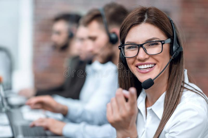 Female call center operator pointing at you stock photo