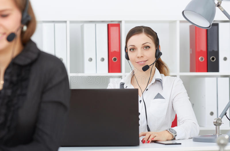 Female call center service operator at work. royalty free stock photos