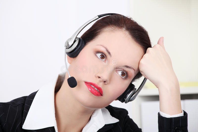 Female call centre employee royalty free stock image