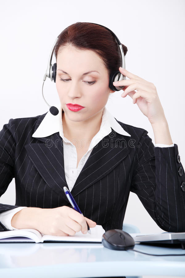 Female call centre employee in headset stock photos