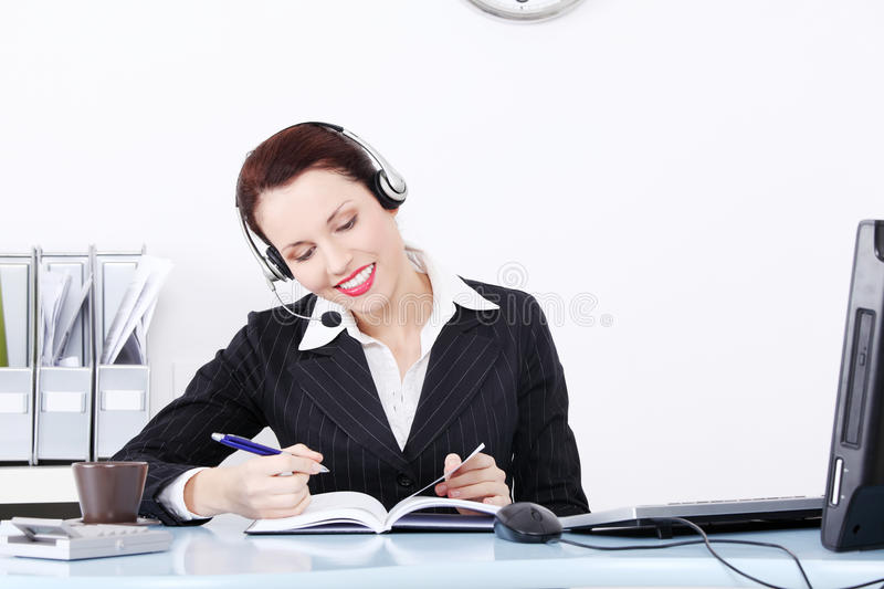 Female call centre employee in headset royalty free stock images