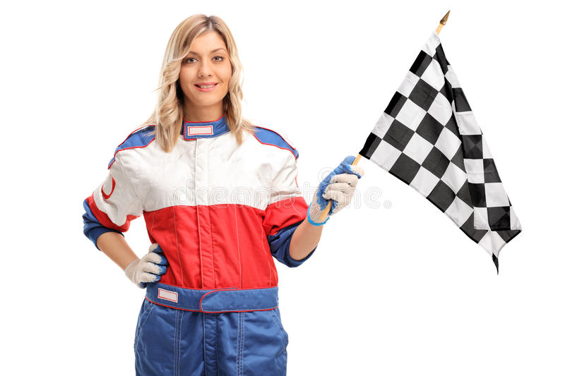 Female car racer waving a checkered race flag. Young female car racer waving a checkered race flag and looking at the camera isolated on white background royalty free stock photos