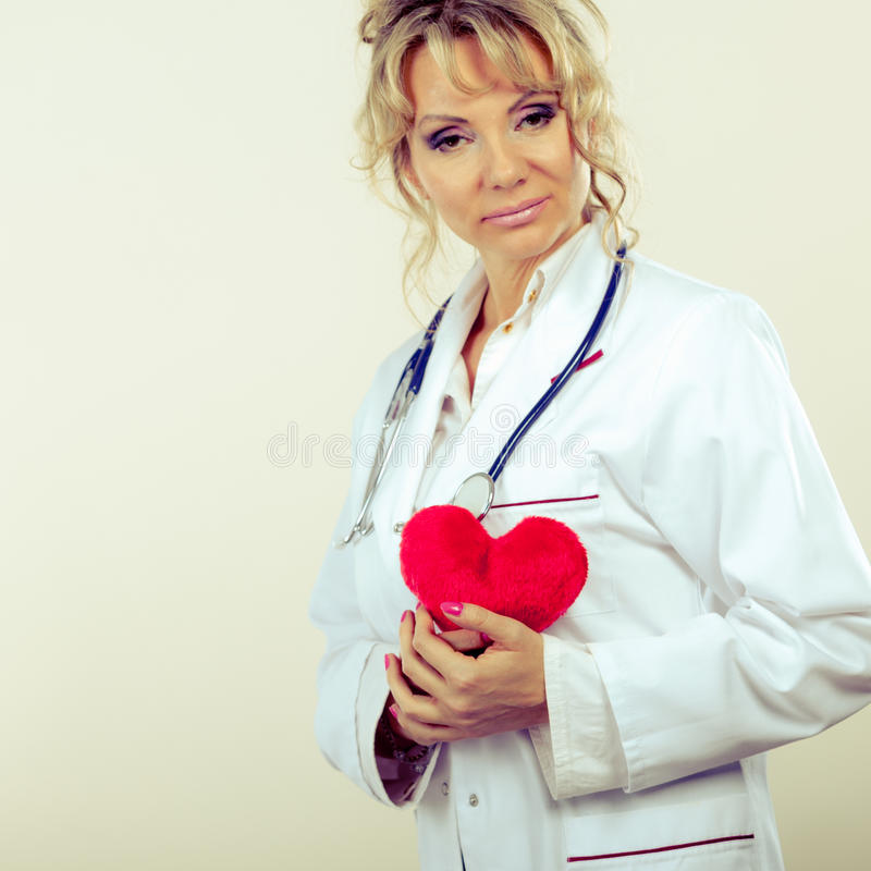 Female cardiologist with red heart. royalty free stock image