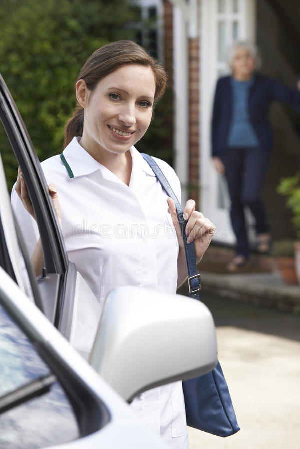 Female Care Worker Visiting Senior Woman At Home stock images