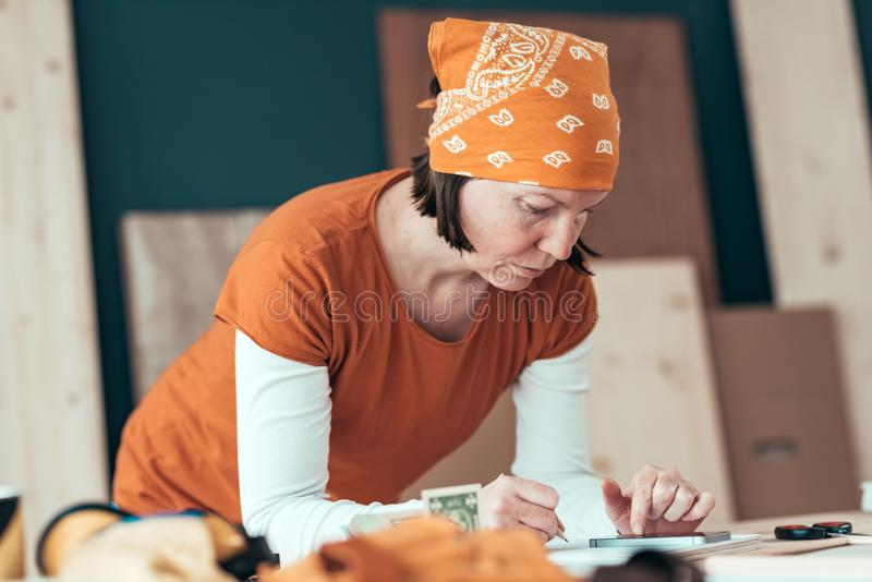 Female carpenter with financial problems stock photography