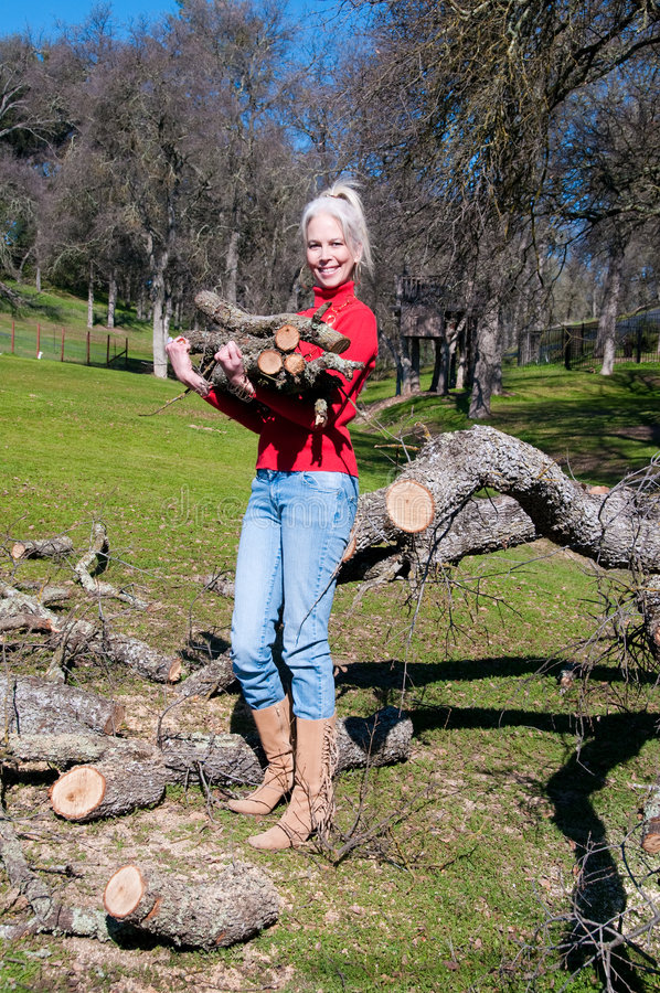 Female Carrying Oak Logs stock photos