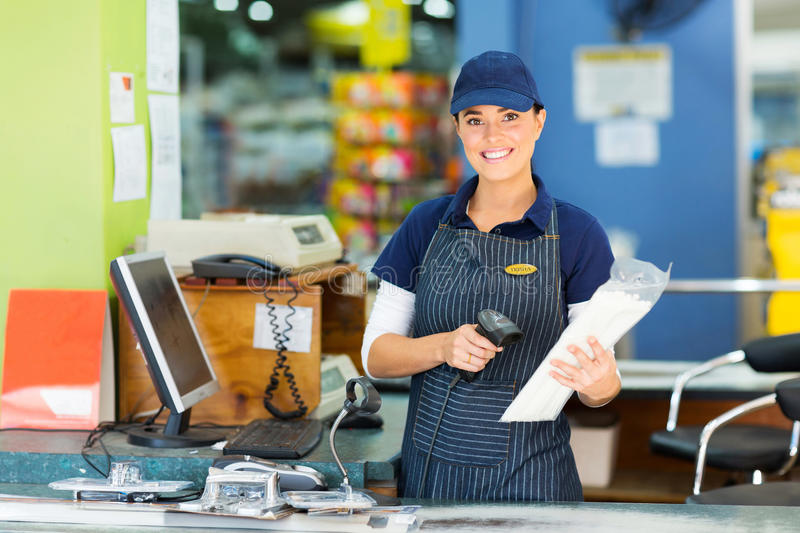 Female cashier store. Attractive female cashier at hardware store stock photography
