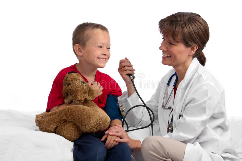 Female caucasian doctor checking boy's pressure royalty free stock photo