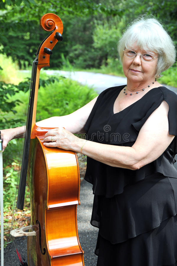 Female cellist. Female cellist performing classical music outdoors stock images