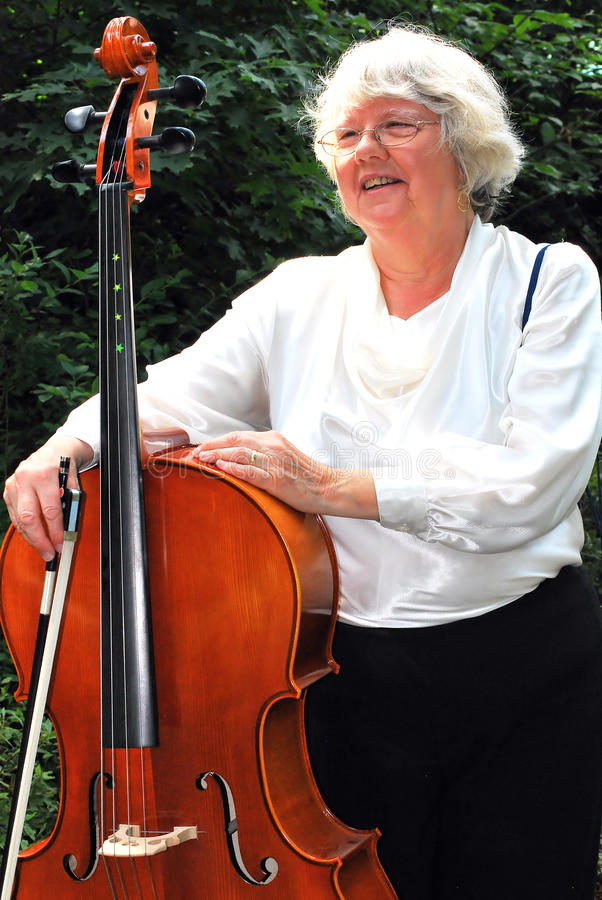 Female cellist expressions. Mature female cellist expressions outside royalty free stock photo