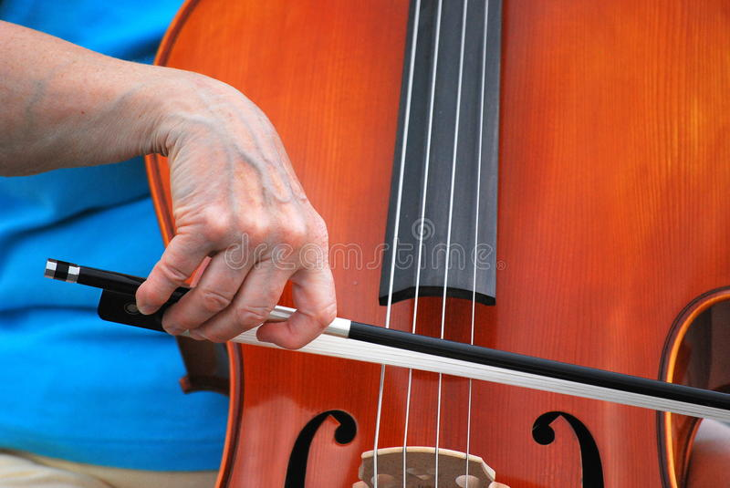 Female cellist performing. Female cellist performing in concert outdoors royalty free stock photos