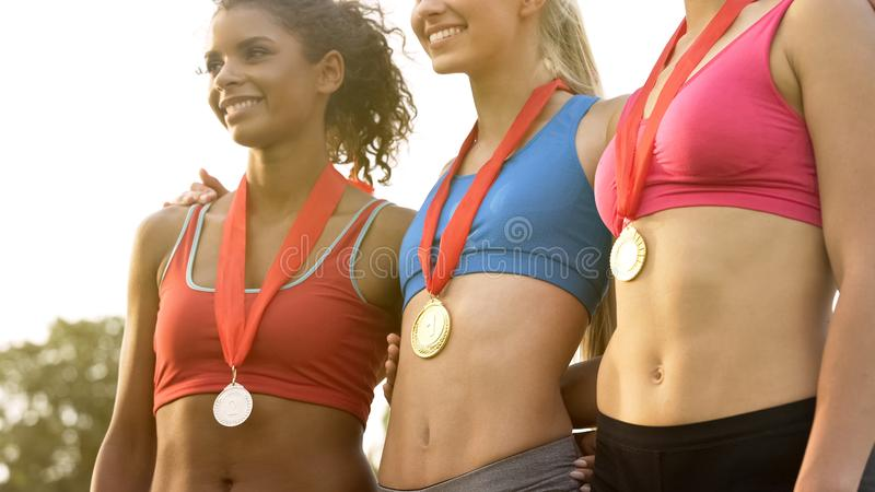 Female champions of national team posing in front of cameras, pride of nation. Stock photo stock images