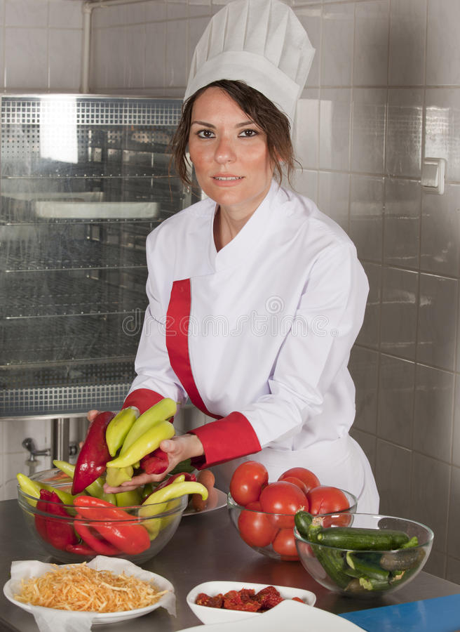 Female chef in kitchen royalty free stock photo