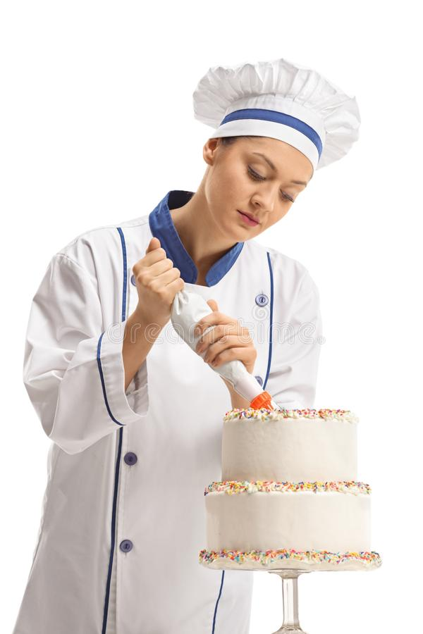 Female chef making a cake stock photography
