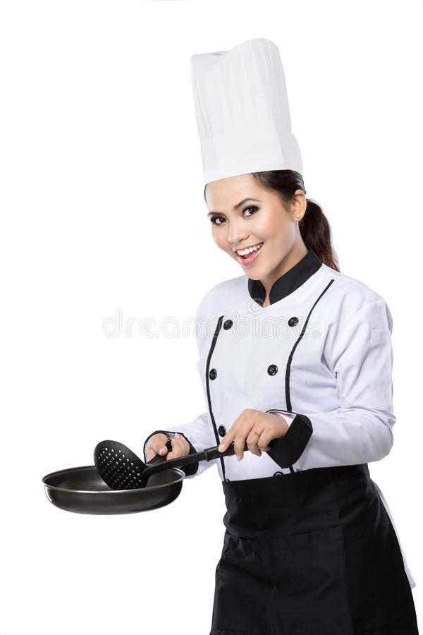 Female chef ready to cook. Portrait of excited female chef ready to cook isolated over white background royalty free stock photos