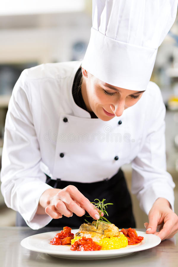 Download Female Chef In Restaurant Kitchen Cooking Stock Image - Image: 26869071