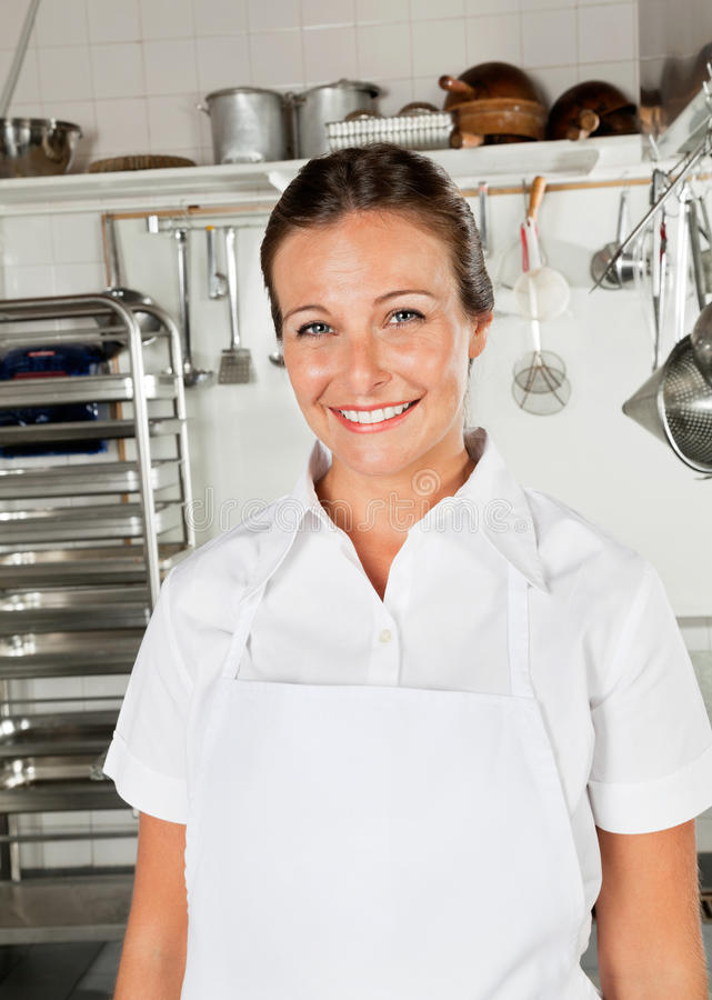 Female Chef In Restaurant Kitchen royalty free stock photo