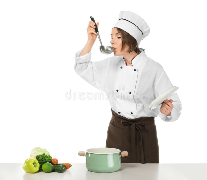 Female chef with saucepan and vegetables. On white background royalty free stock photos