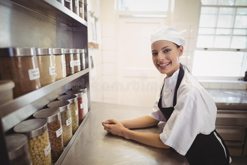 Female chef standing in the commercial kitchen royalty free stock photos