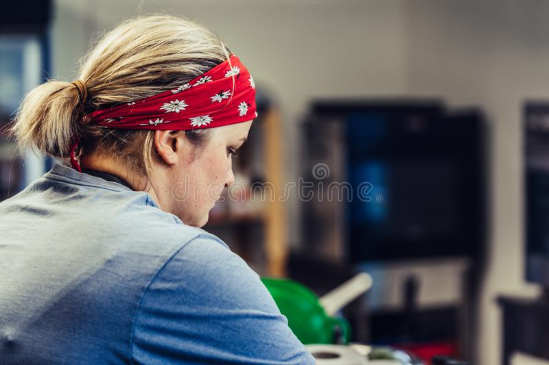 Female Chef Taking a Break from Meal Preparation - Frustrated, Worried, Concept of a Hard Working Person. Vintage Film Look royalty free stock photo